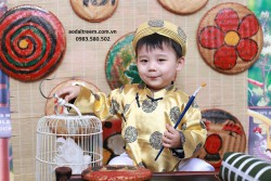 Áo dài trẻ em - Gấm Thái Tuấn màu vàng đồng